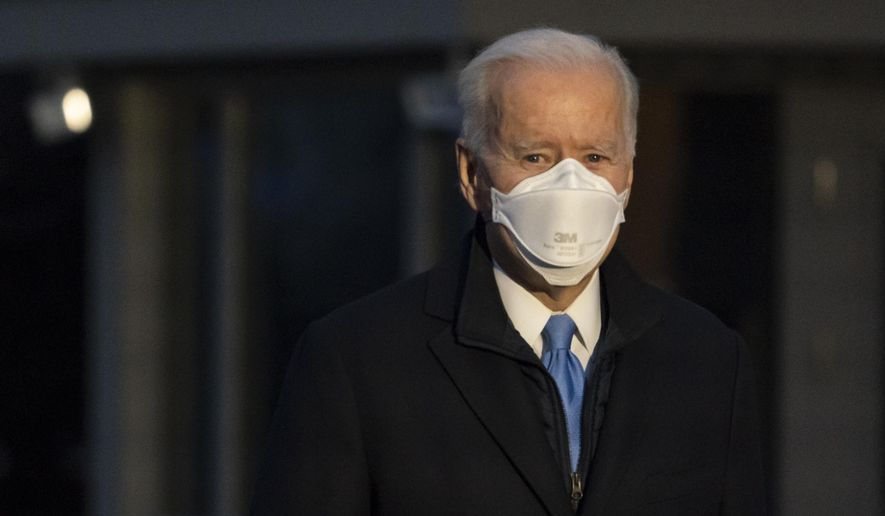 President Joe Biden pauses to speak with reporters as he walks to Marine One for departure from the South Lawn of the White House, Friday, Feb. 12, 2021, in Washington. Biden is en route to Camp David. (AP Photo/Alex Brandon)