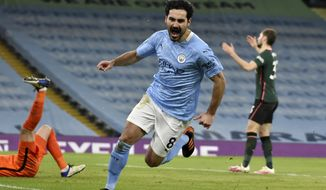 Manchester City's Ilkay Gundogan celebrates after scoring his side's second goal during the English Premier League soccer match between Manchester City and Tottenham Hotspur at Etihad Stadium, Manchester, England, Saturday, Feb. 13, 2021. (AP photo/Rui Vieira, Pool)