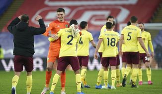 Burnley players celebrate after the English Premier League soccer match between Crystal Palace and Burnley at Selhurst Park stadium in London, England, Saturday, Feb. 13, 2021. (John Walton/Pool via AP)