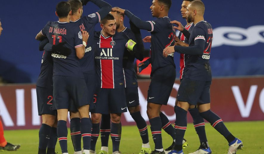 PSG players celebrate their third goal during the French League One soccer match between Paris Saint-Germain and Montpellier at the Parc des Princes stadium in Paris, France, Friday, Jan.22, 2021. (AP Photo/Thibault Camus)