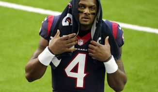 FILE - In this Jan. 3, 2021, file photo, Houston Texans quarterback Deshaun Watson walks off the field before an NFL football game against the Tennessee Titans in Houston. J.J. Watt is gone from the Texans and Watson wants out, too. The Texans have been making plenty of headlines this offseason. Not one has been good. (AP Photo/Eric Christian Smith, File)