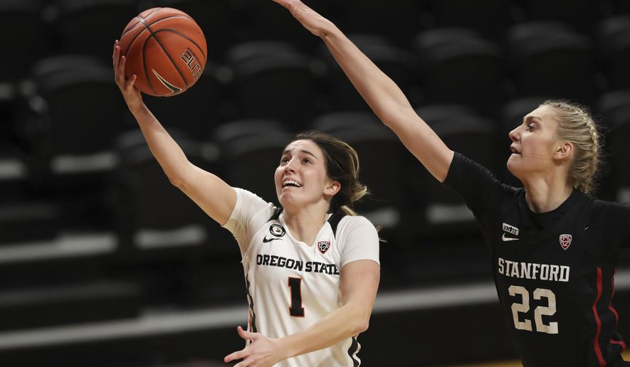 Stanford's Cameron Brink (22) tries to block a shot by Oregon State's Aleah Goodman (1) during the first half of an NCAA college basketball game in Corvallis, Ore., Saturday, Feb. 13, 2021. (AP Photo/Amanda Loman)