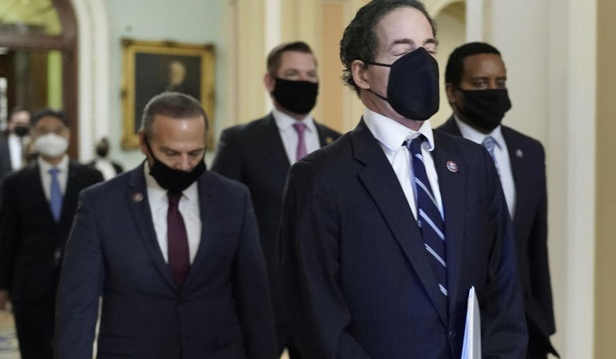 House impeachment managers, led by Rep. Jamie Raskin, D-Md., walk out of the Senate Chamber in the Capitol at the end of the fifth day of the second impeachment trial of former President Donald Trump, Saturday, Feb. 13, 2021, in Washington. The Senate has acquitted Donald Trump of inciting the Jan. 6 attack on the U.S. Capitol, bringing his trial to a close and giving the former president a historic second victory in the court of impeachment. (AP Photo/J. Scott Applewhite)