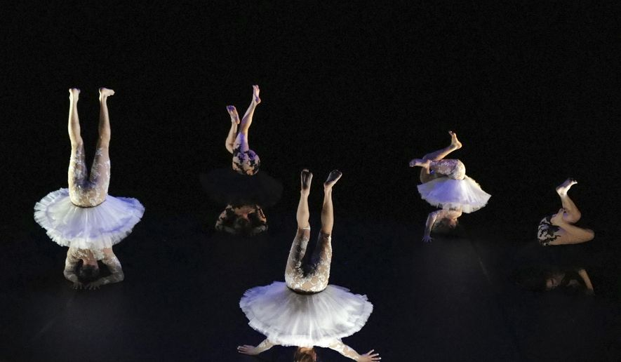 """Dancers, from left to right, Joaquin Medina Caligari from Uruguay, Tasha Petersen from Argentina, Valentino Martinetti from Argentina, Marius Fouilland from France and Lucille Chalopin from Paris, of the Eolienne company perform """"Le Lac des Cygnes"""" by Florence Caillon, based on Tchaikovsky's Swan Lake during the BIAC, International Circus Arts Biennale, in Marseille, south of France, Thursday, Feb. 4, 2021. The fourth edition of the global Circus Biennale is demonstrating how the performing arts have a way of flourishing in between the cracks, celebrating the death-defying and spine stretching arts that go behind the storied spectacle. (AP Photo/Francois Mori)"""