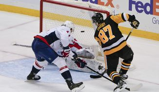 Pittsburgh Penguins' Sidney Crosby (87) has a shot blocked by Washington Capitals goaltender Vitek Vanecek during the first period of an NHL hockey game, Sunday, Feb. 14, 2021, in Pittsburgh. (AP Photo/Keith Srakocic)
