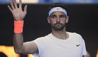 Buglaria's Grigor Dimitrov celebrates his win over Austria's Dominic Thiem in their fourth round match at the Australian Open tennis championships in Melbourne, Australia, Sunday, Feb. 14, 2021. (AP Photo/Andy Brownbill)