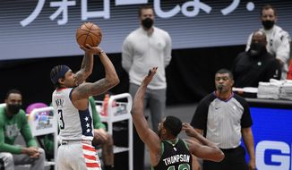 Washington Wizards guard Bradley Beal (3) shoots against Boston Celtics forward Tristan Thompson (13) during the first half of an NBA basketball game, Sunday, Feb. 14, 2021, in Washington. (AP Photo/Nick Wass)