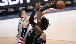 Washington Wizards center Moritz Wagner (21) is called for a foul on Boston Celtics center Robert Williams III (44) during the first half of an NBA basketball game, Sunday, Feb. 14, 2021, in Washington. (AP Photo/Nick Wass)