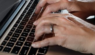 In this Monday, June 19, 2017, photo, a person types on a laptop keyboard, in North Andover, Mass. (Associated Press)