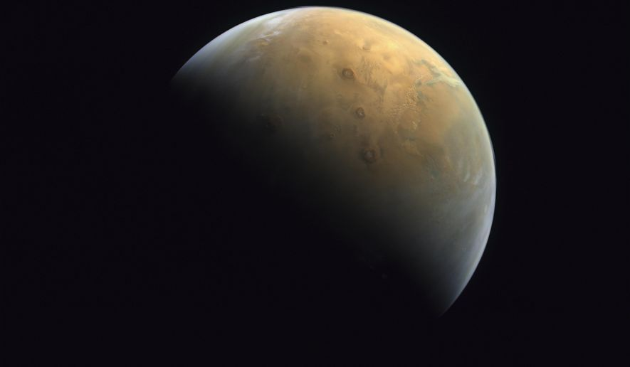 """This Feb. 10, 2021 image taken by the United Arab Emirates' """"Amal,"""" or """"Hope,"""" probe was released Sunday, Feb. 14, 2021, shows Mars . The Hope space probe now circles the red planet. (Mohammed bin Rashid Space Center/UAE Space Agency, via AP)"""