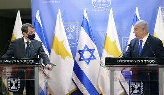 Cyprus President Nicos Anastasiades, left, and Israeli Prime Minister Benjamin Netanyahu deliver statements after meeting in Jerusalem, Sunday, Feb. 14, 2021. (Marc Israel Sellem/Pool via AP)