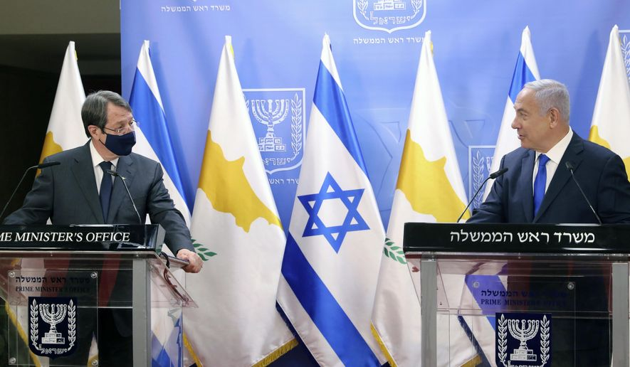 Cyprus President Nicos Anastasiades, left, and Israeli Prime Minister Benjamin Netanyahu deliver statements after meeting in Jerusalem, Sunday, Feb. 14, 2021. (Marc Israel Sellem/Pool via AP)