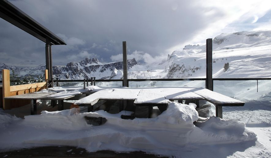 """FILE - In this Friday, Jan. 29, 2021 file photo, a view of the closed hut """"Rifugio Scoiattoli"""" in Cortina D'Ampezzo, Italy. On the eve of what was supposed to finally be the repeatedly delayed opening of Italy's ski slopes, the government on Sunday, Feb. 14, 2021, yanked permission because a coronavirus variant was found to be circulating in a good portion of recently infected persons. Health Minister Roberto Speranza's ordinance forbids amateur skiing at least until March 5. (AP Photo/Antonio Calanni, File)"""