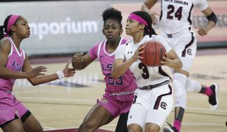 South Carolina guard Destanni Henderson (3) drives to the hoop against LSU guard Karli Seay (23) and Khayla Pointer (3) during the first half of an NCAA college basketball game Sunday, Feb. 14, 2021, in Columbia, S.C. (AP Photo/Sean Rayford)