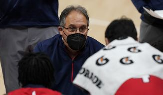 New Orleans Pelicans head coach Stan Van Gundy talks to the team during the first half of an NBA basketball game against the Detroit Pistons, Sunday, Feb. 14, 2021, in Detroit. (AP Photo/Carlos Osorio)