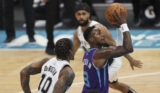 Charlotte Hornets guard Terry Rozier drives to the basket past San Antonio Spurs forward DeMar DeRozan (10) during the first half of an NBA basketball game in Charlotte, N.C., Sunday, Feb. 14, 2021. (AP Photo/Nell Redmond)