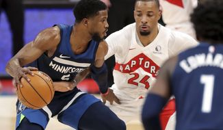 Minnesota Timberwolves' Malik Beasley, left, is defended by Toronto Raptors' Norman Powell during the first half of an NBA basketball game Sunday, Feb. 14, 2021, in Tampa, Fla. (AP Photo/Mike Carlson)