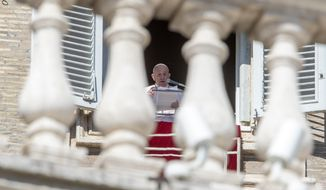 Pope Francis delivers his blessing as he recites the Angelus noon prayer from the window of his studio overlooking St.Peter's Square, at the Vatican, Sunday, Feb. 14, 2021. (AP Photo/Andrew Medichini)