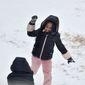 Shamiya Evans, 9, throws a handful of snow at Kynlee Kelly, 8, in Ridgeland, Mississippi.