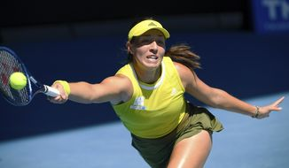 United States' Jessica Pegula hits a forehand return to Ukraine's Elina Svitolina during their fourth round match at the Australian Open tennis championship in Melbourne, Australia, Monday, Feb. 15, 2021.(AP Photo/Andy Brownbill)