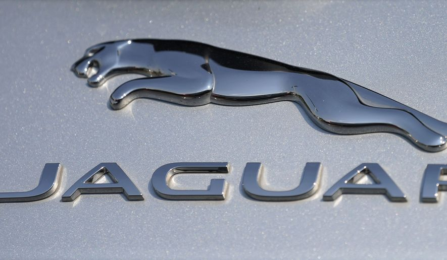 In this file photo dated Sunday, Sept. 6, 2020, the Jaguar car company logo shines off the deck of an I-Pace electric vehicle at a Jaguar dealership, in Littleton, USA.  Struggling luxury car brand Jaguar will be fully electric by 2025, the British company said Monday Feb. 15, 2021, as it outlined a plan to phase out internal combustion engines.(AP Photo/David Zalubowski, FILE)