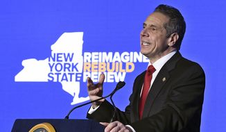 In this Jan. 11, 2021, photo, New York Gov. Andrew Cuomo delivers his State of the State address virtually from The War Room at the state Capitol, in Albany, N.Y. (AP Photo/Hans Pennink, Pool) **FILE**
