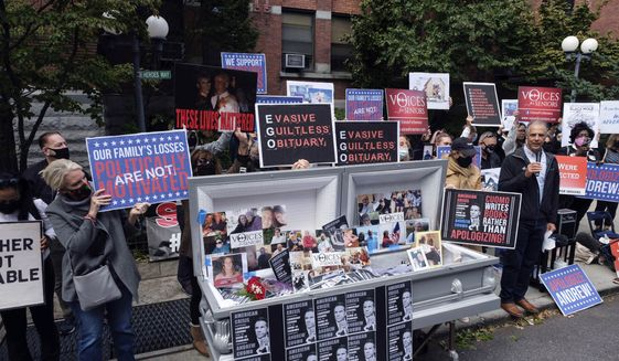 In this Oct. 18, 2020, file photo, families of COVID-19 victims who passed away in New York nursing homes, gather in front of the Cobble Hill Health Center in the Brooklyn borough of New York, to demand New York Gov. Andrew Cuomo apologize for his response to clusters in nursing homes during the pandemic. (AP Photo/Yuki Iwamura, File)