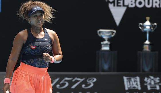 Japan's Naomi Osaka reacts after defeating Taiwan's Hsieh Su-wei in their quarterfinal match at the Australian Open tennis championship in Melbourne, Australia, Tuesday, Feb. 16, 2021.(AP Photo/Hamish Blair)
