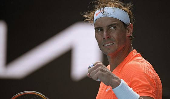 Spain's Rafael Nadal celebrates after defeating Italy's Fabio Fognini in their fourth round match at the Australian Open tennis championship in Melbourne, Australia, Monday, Feb. 15, 2021.(AP Photo/Andy Brownbill)