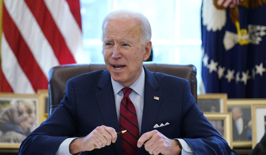 In this Jan. 28, 2021 file photo, President Joe Biden signs a series of executive orders in the Oval Office of the White House in Washington. Biden campaigned on raising the national minimum wage to $15 per hour and attached a proposal doing just that to the $1.9 trillion coronavirus pandemic relief bill. (AP Photo/Evan Vucci) **FILE**