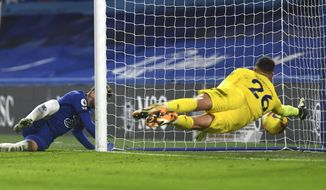 Chelsea's Timo Werner, left, scores his side's second goal during the English Premier League soccer match between Chelsea and Newcastle United at Stamford Bridge Stadium in London, England, Monday, Feb. 15, 2021. (Mike Hewitt /Pool via AP)