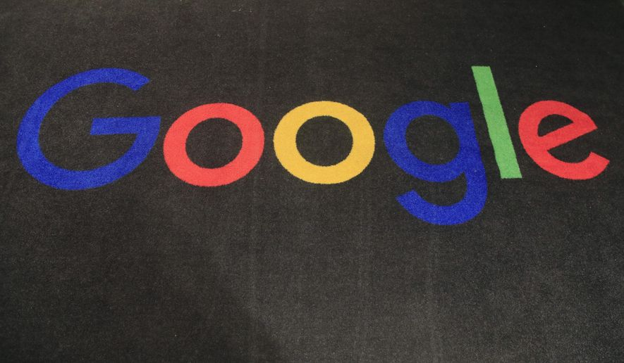 """FILE - In this Monday, Nov. 18, 2019, file photo, the logo of Google is displayed on a carpet at the entrance hall of Google France in Paris. Google has agreed to pay a fine 1.1 million euros ($1.3 million) after French authorities concluded the search engine was featuring """"misleading"""" rankings for French hotels. (AP Photo/Michel Euler, File)"""