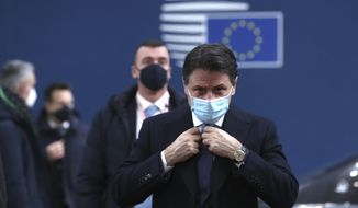 In this Thursday, Dec. 10, 2020, file photo, Italy's Prime Minister Giuseppe Conte arrives for an EU summit at the European Council building in Brussels. (Yves Herman, Pool via AP) ** FILE **