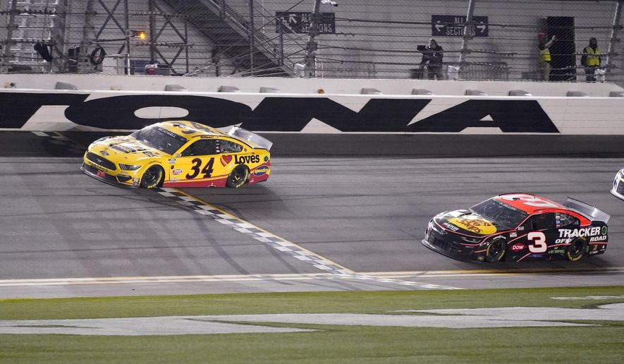 Michael McDowell crosses the finish line ahead of Austin Dillon to win the NASCAR Daytona 500 auto race at Daytona International Speedway, Monday, Feb. 15, 2021, in Daytona Beach, Fla. (AP Photo/John Raoux)