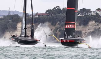 Italy's Luna Rossa, right, leads Britain's INEOS Team UK to win race three of the Prada Cup on Auckland's Waitemata Harbour, New Zealand, Sunday, Feb.14, 2021. (Brett Phibbs/NZ Herald via AP)