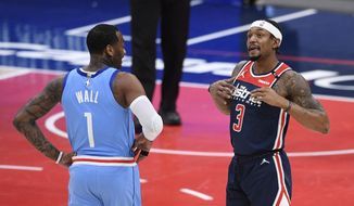 Houston Rockets guard John Wall (1) and Washington Wizards guard Bradley Beal (3) stand on the court during the first half of an NBA basketball game, Monday, Feb. 15, 2021, in Washington. (AP Photo/Nick Wass)