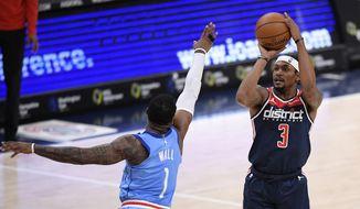 Washington Wizards guard Bradley Beal (3) shoots against Houston Rockets guard John Wall (1) during the first half of an NBA basketball game, Monday, Feb. 15, 2021, in Washington. (AP Photo/Nick Wass)