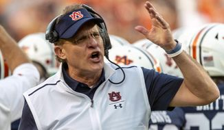 FILE - Auburn head coach Gus Malzahn argues a call during the first half of an NCAA college football game against Alabama in Auburn, Ala., in this Saturday, Nov. 30, 2019, file photo. Central Florida hired Gus Malzahn as its football coach Monday, Feb. 15, 2021, a little more than two months after he was fired by Auburn.(AP Photo/Vasha Hunt, File)
