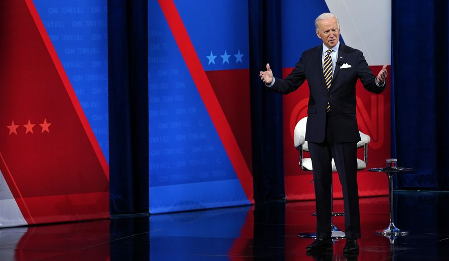 President Joe Biden speaks during a televised town hall event at Pabst Theater, Tuesday, Feb. 16, 2021, in Milwaukee. (AP Photo/Evan Vucci)