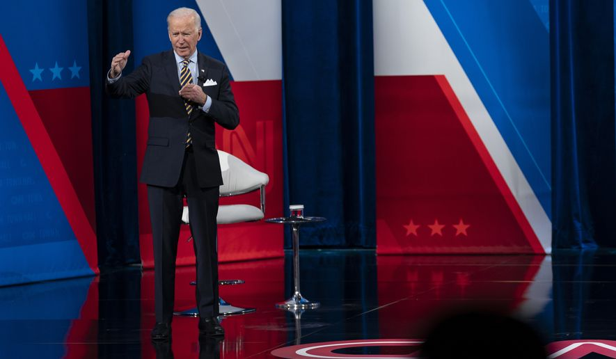 President Joe Biden participates in a televised town hall event at Pabst Theater, Tuesday, Feb. 16, 2021, in Milwaukee. (AP Photo/Evan Vucci)