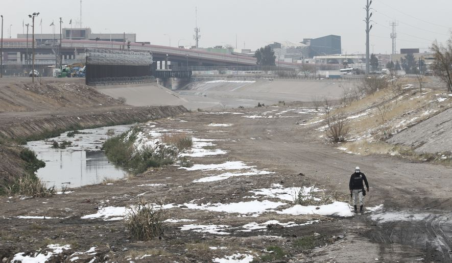 A national guardsman patrols the Mexican side of the Rio Bravo on the border with the U.S. in Ciudad Juarez, Chihuahua state, Tuesday, Feb. 16, 2021, in this file photo. (AP Photo/Christian Chavez)  **FILE**