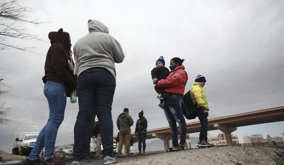 Honduran and Cuban migrants are questioned by Mexican migration authorities after attempting to cross the Rio Bravo on the border with the U.S., in Ciudad Juarez, Chihuahua state, Mexico, Tuesday, Feb. 16, 2021. The number of people apprehended at the U.S.-Mexico border has increased since Jan. with migrant families crossing from Ciudad Juarez and turning themselves over to Border Patrol. (AP Photo/Christian Chavez) **FILE**