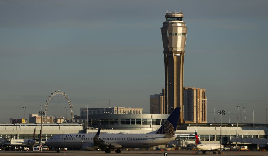 In this March 19, 2020, file photo a plane takes off at McCarran International airport, in Las Vegas. A county board voted unanimously Tuesday, Feb. 16, 2021, to rename busy McCarran International Airport in Las Vegas after former U.S. Sen. Harry Reid of Nevada. (AP Photo/John Locher, File) **FILE**