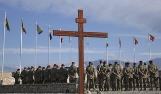 In this, Nov. 7, 2014, photo, German soldiers participate in a memorial ceremony recalling those killed on allied missions, during a visit by NATO Secretary-General Jens Stoltenberg, at the German NATO base, Camp Marmal, Mazar-i Sharif, Afghanistan. After 20 years of military engagement and billions of dollars spent, NATO and the United States still grapple with the same, seemingly intractable conundrum — how to withdraw troops from Afghanistan without abandoning the country to even more mayhem. Currently, 2,500 U.S. and about 10,000 NATO troops are still in Afghanistan. (AP Photo/Massoud Hossaini) **FILE**