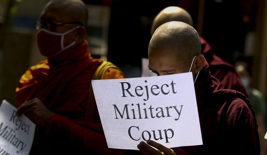 Buddhist monks display placrds during a protest march against the military coup in Yangon, Myanmar Tuesday, Feb. 16, 2021. Peaceful demonstrations against Myanmar's military takeover resumed Tuesday, following violence against protesters a day earlier by security forces and after internet access was blocked for a second straight night. (AP Photo)