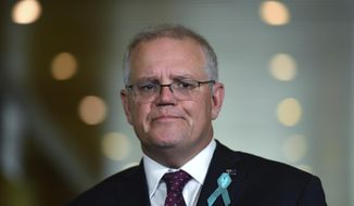 Australian Prime Minister Scott Morrison speaks at a press conference to discuss sexual assault allegations against a male staffer at Parliament House in Canberra, Tuesday, Feb. 16, 2021. Morrison apologized to a former government staffer who alleged she was raped by a colleague in a minister's office two years ago. (Mick Tsikas/AAP Image via AP)