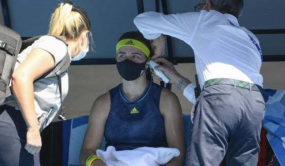 Karolina Muchova of the Czech Republic receives medical treatment during her quarterfinal against Australia's Ash Barty at the Australian Open tennis championship in Melbourne, Australia, Wednesday, Feb. 17, 2021.(AP Photo/Andy Brownbill)