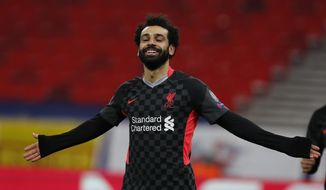 Liverpool's Mohamed Salah celebrates after scoring his side's first goal during the Champions League round of 16, first leg, soccer match between RB Leipzig and Liverpool at the Ferenc Puskas stadium in Budapest, Hungary, Tuesday, Feb. 16, 2021. (AP Photo/Laszlo Balogh)