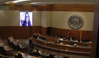 State Rep. Georgene Louis, of Bernalillo County, appears via video to legislators and staff at the state House on Tuesday, Feb. 16, 2021, in Santa Fe, New Mexico. Louis presented a bill that would strip qualified immunity for most officials. The bill has grown out of recommendations from a bipartisan civil rights commission created after the killing of George Floyd in Minnesota. (AP Photo/Cedar Attanasio)