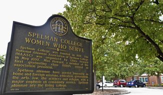 A sign is displayed at Spelman College on Sept. 26, 2018, Atlanta. Several historically Black colleges and universities, including Spelman College, will receive more than $650,000 in grants to preserve their campuses as part of a new initiative announced Tuesday, Feb. 16, 2021. (Hyosub Shin/Atlanta Journal-Constitution via AP)